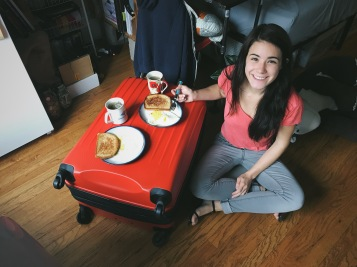 Since all my things were everywhere, we ate breakfast on top of my suitcase!
